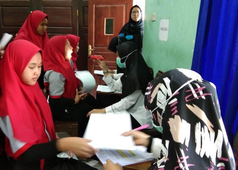 Motivasi Kesehatan Diri Tim Puskesmas Dinoyo Screning Siswa SMK Muda 2