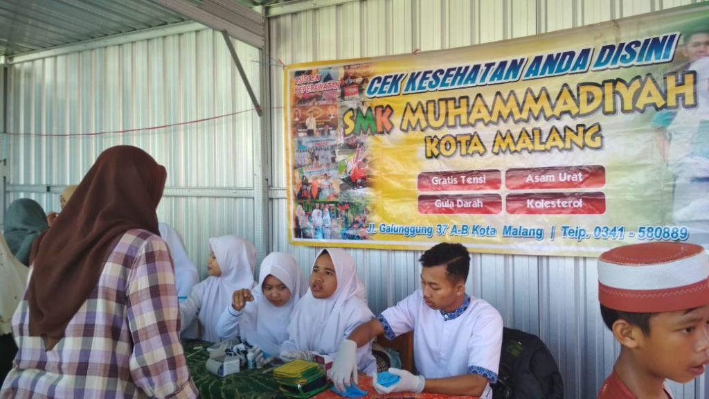 SD Mulia Gandeng SMK Muhammadiyah 1 Kota Malang Servis Motor-Cek Kesehatan Gratis 2