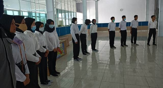 Ketua Dikdasmen Kota Malang Pesan 4 Prinsip Kerja Wisuda Siswa SMK Muda 1